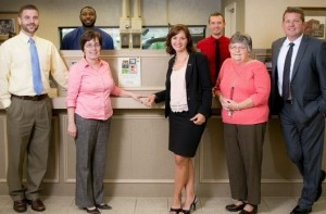 Bank of Oak Ridge branch employees in front of teller counter